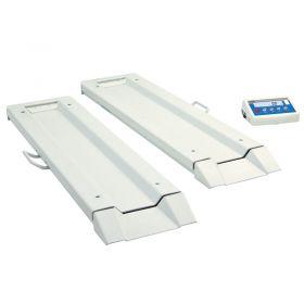 Balance lit au sol WPT/8B 300C - L'application de longues plateformes de pesage rend possible la mesure de la masse d'un lit dans n'importe quel de la balance. La voie reglée des plate-formes de 2,5 mètres permet l'application de la balance pour des lits de toutes les dimensions